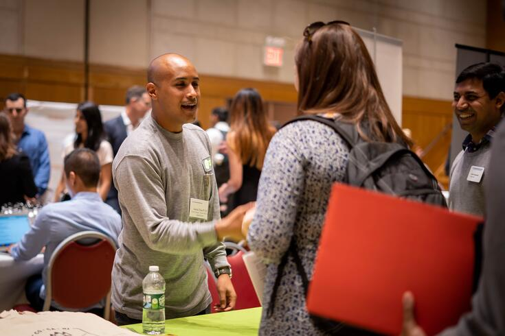 A student meets with an HR manager during a recruiting event